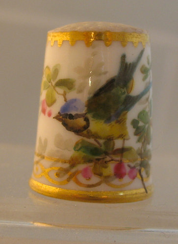 Porcelain thimble with swallow