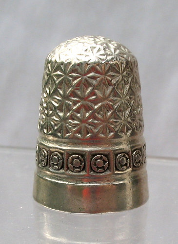 Silver thimble with a border of roundels
