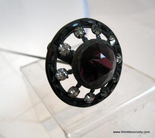 Purple glass hat pin c.1900