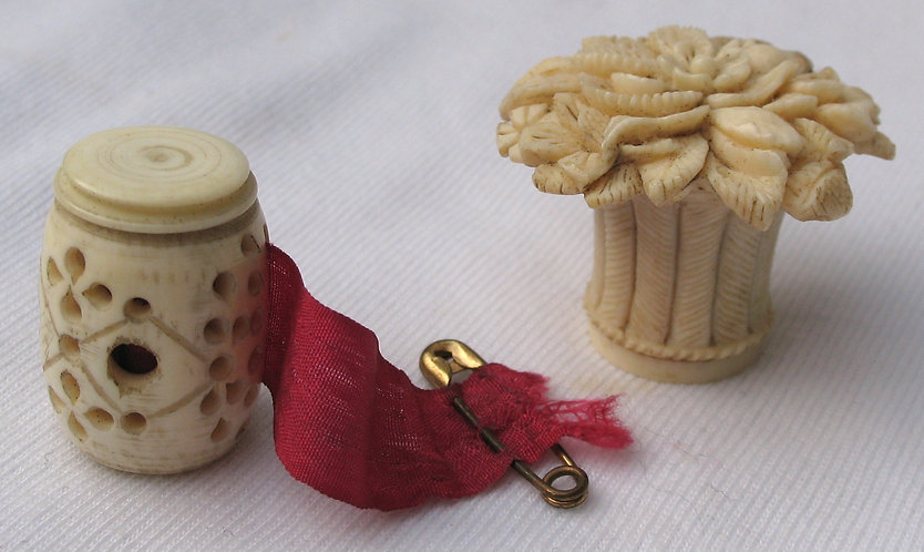 Two ivory or bone tape measures