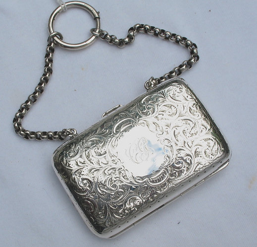 Decoratively engraved silver purse