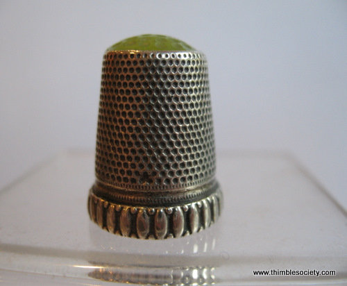 Silver thimble, green stone/glass top
