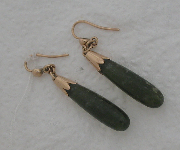 Pair of transparent green quartz earrings mounted in gold.