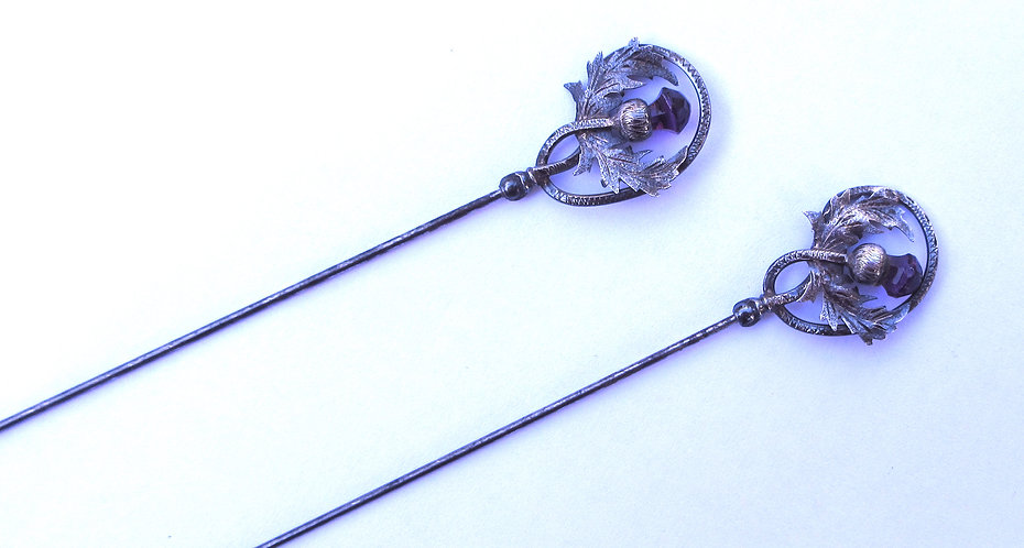 Thistle topped silver hat pins with amethyst and citrines.