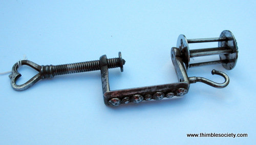 Steel sewing clamp with cotton thread holder