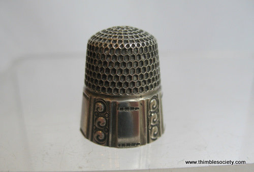 Silver thimble scroll border
