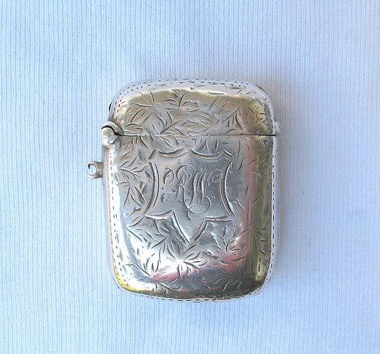 Silver vesta with decorative initials in a star shaped cartouche