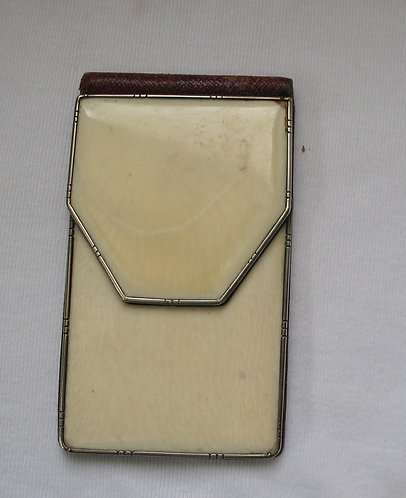 Ivory purse with silver trim
