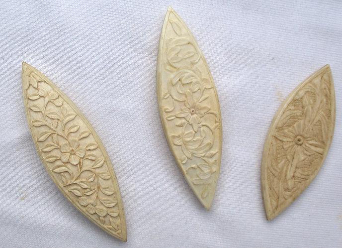 Carved bone or ivory shuttles