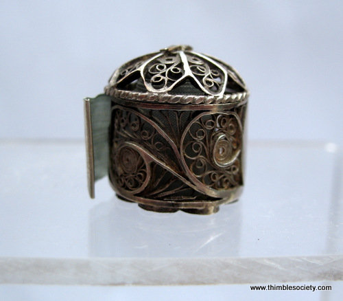Silver filigree tape measure