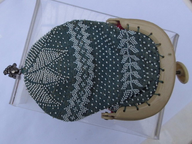 Fine knitted and decorated with beads-purse