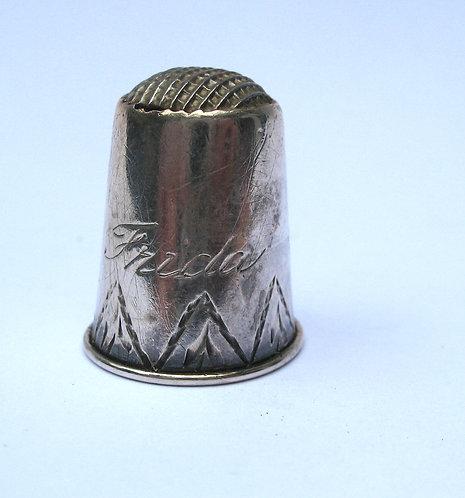 Thimble, silver, engraved 'Frida'.