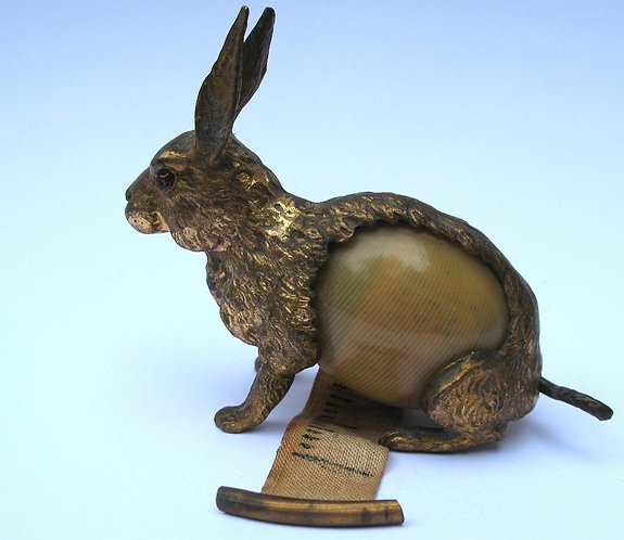 Tape measure, gilded metal hare.