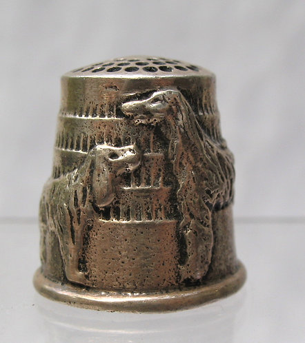 Silver thimble with raised figures of two dogs