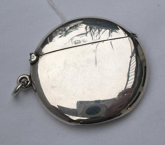 Round silver vesta