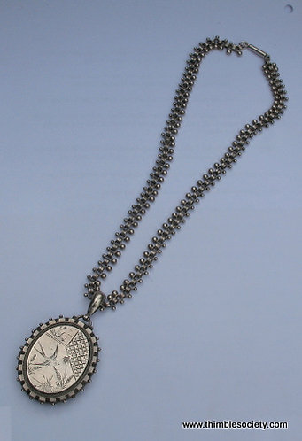 silver [hall marked] locket on a silver chain C99