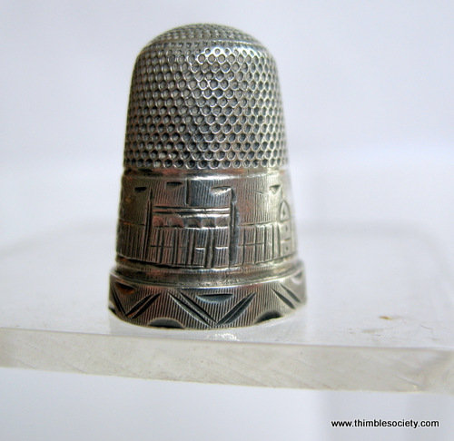 Silver thimble showing engraved view of Crystal Palace exhibition cir 1850s