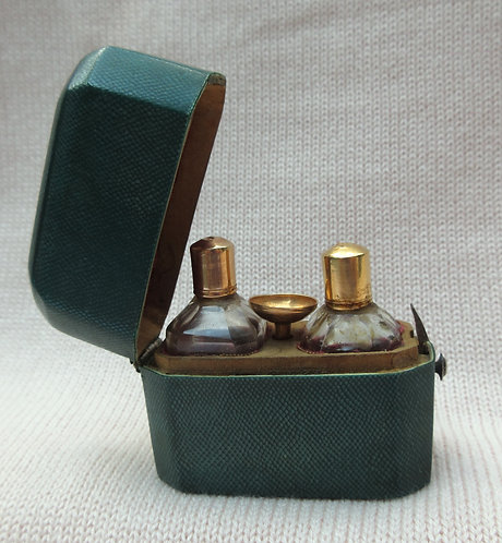 Gold top scent bottles and gold scent funnel