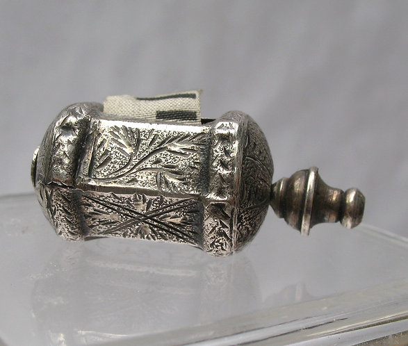 Delicatly engraved silver tape measure