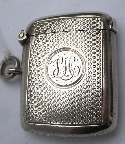 Silver vesa with centrally engraved initials