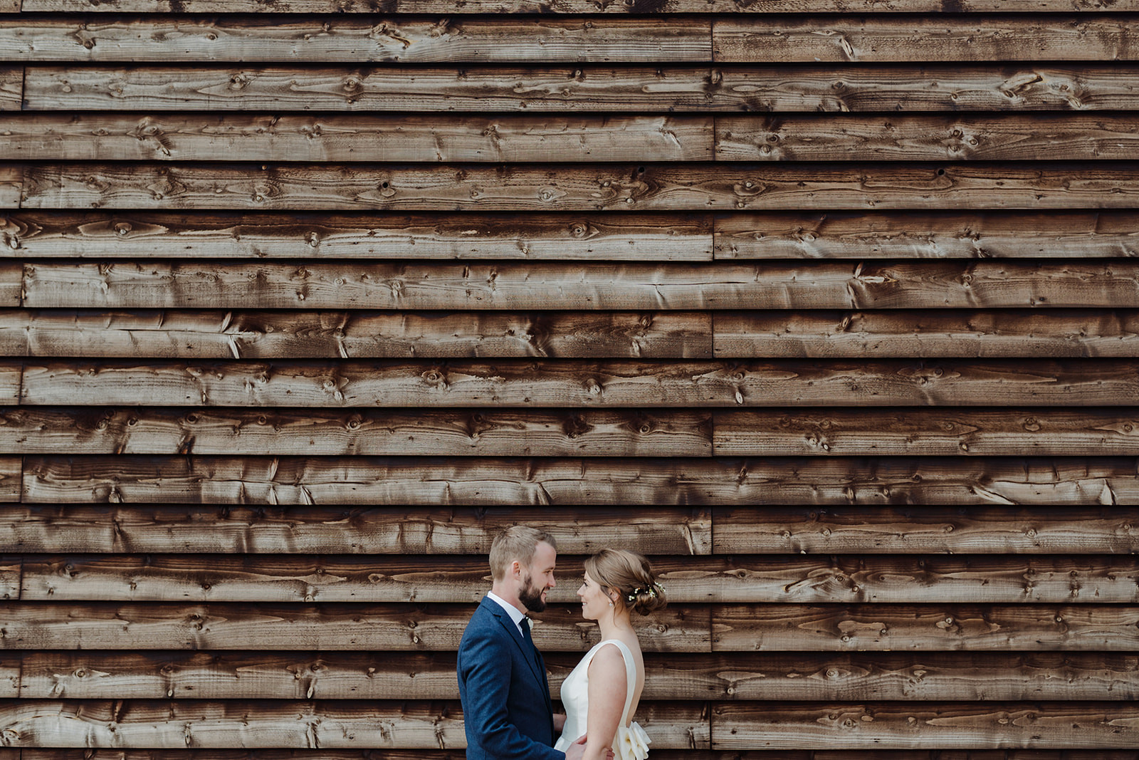 Couple In front of barn by Chloe Ely Photography Wedding Photographer