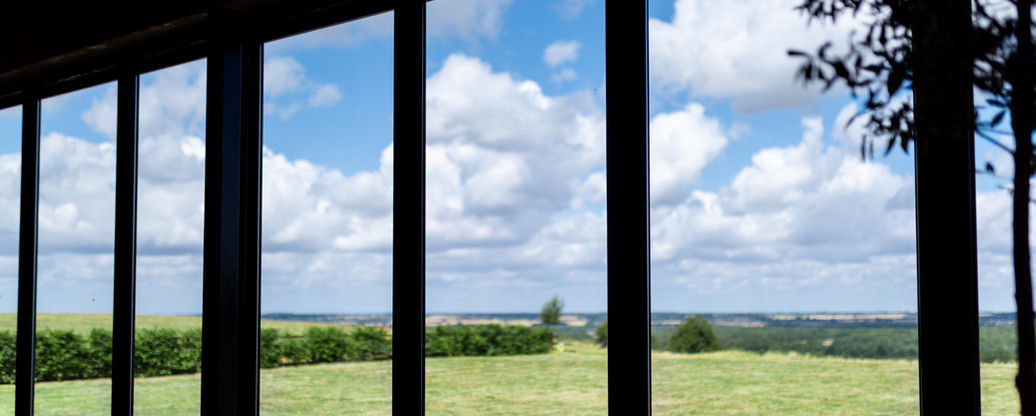 Panoramic windows Primrose Hill Farm Wedding Venue with view of the cotswolds
