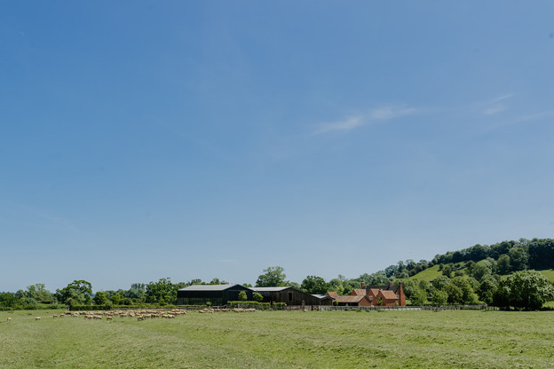 Full Barns view at Primrose Hill Farm Wedding Venue with view of the cotswolds