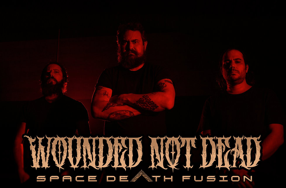 Wounded Not Dead Promo Pic.jpg