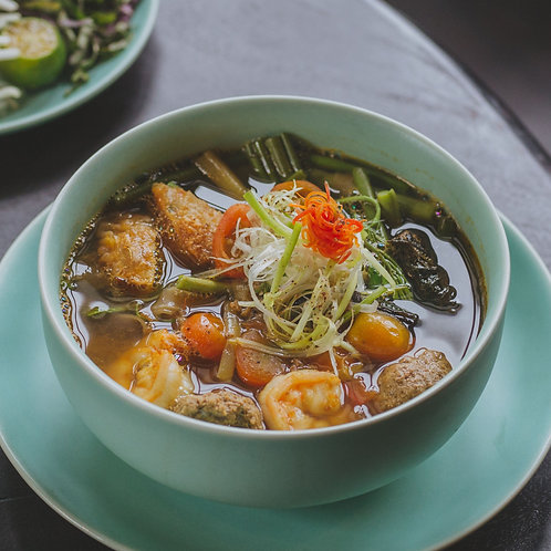 Bánh đa cua/Flat noodles soup with minced crab served with fresh herbs