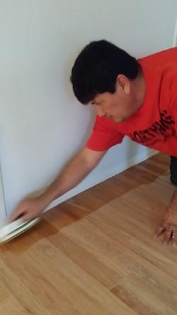 Hand staining wood floor