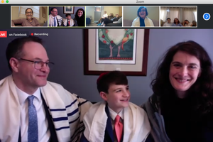 Eli Coustan with his parents, Charles and Hillary, during his Zoom bar mitzvah ceremony. Along the top are friends and family, including the Rabbi (Eli's aunt), Andrea London.