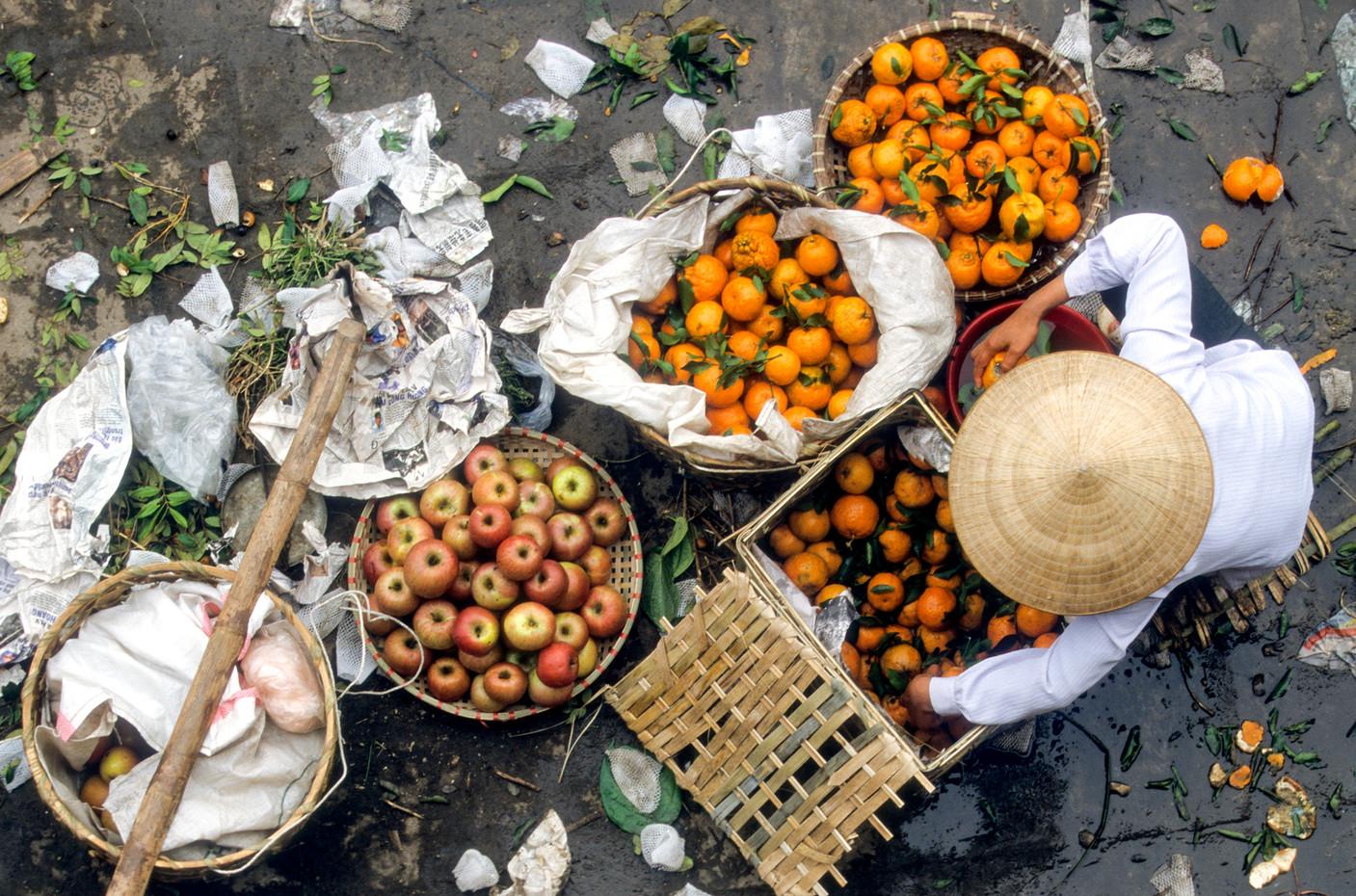 Fruit seller in Hanoi, Vietnam.