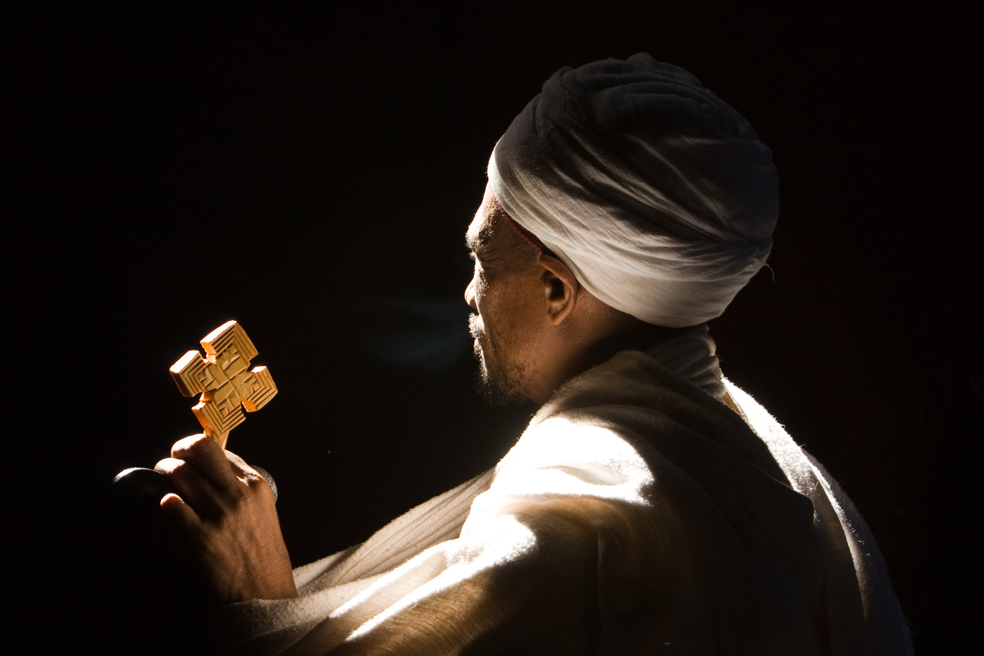 Priest in one of Lalibela's rock-hewn churches, Ethiopia