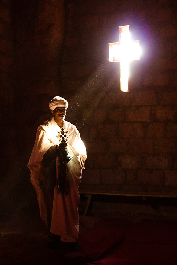 Priest in the rock-hewn churches of Lalibela, E