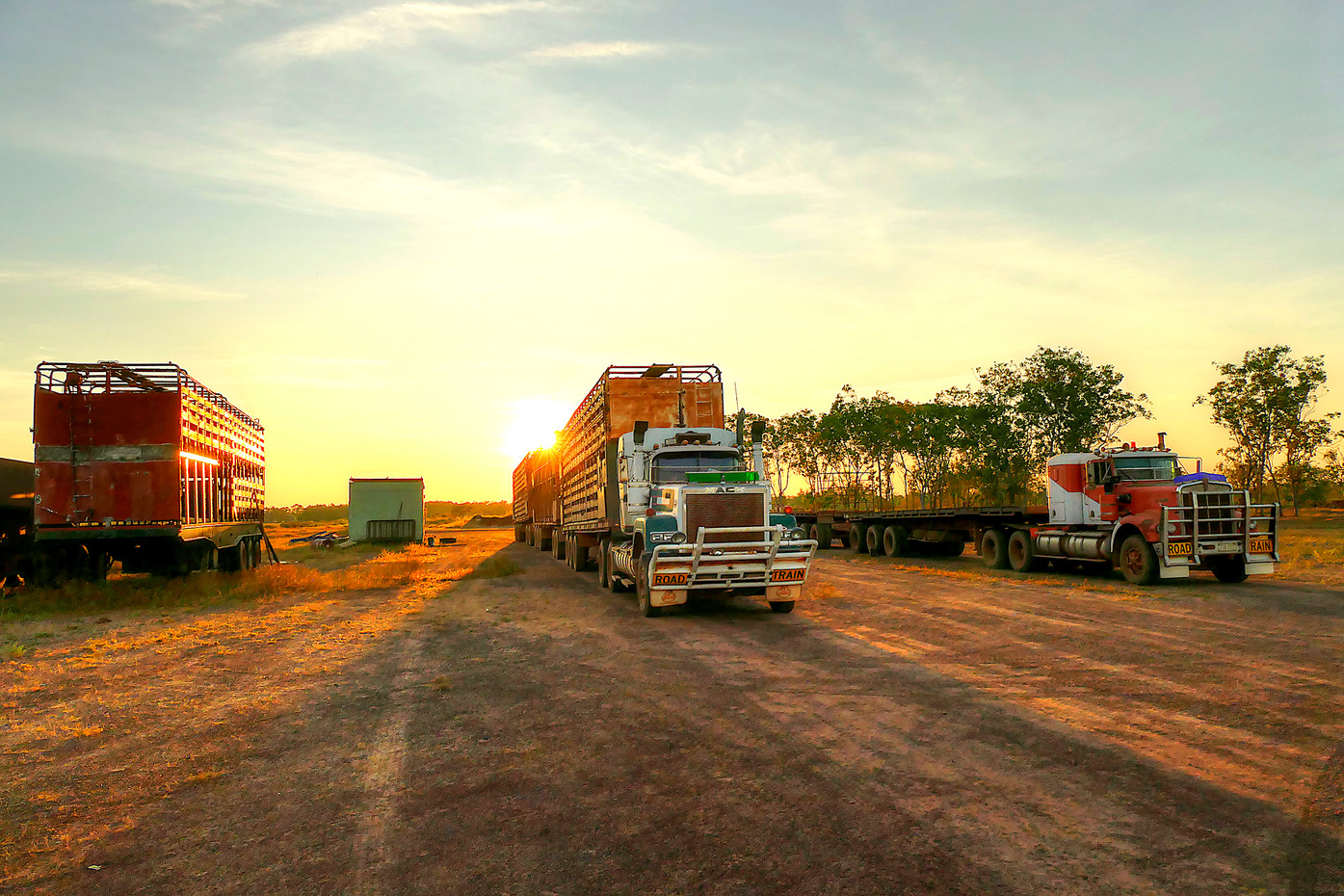 Road Trains at sunset in the Northern Territory, Australia