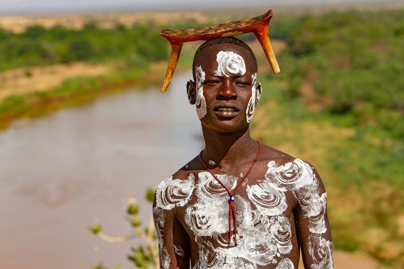Karo tribesman on the Omo River, Ethiopia