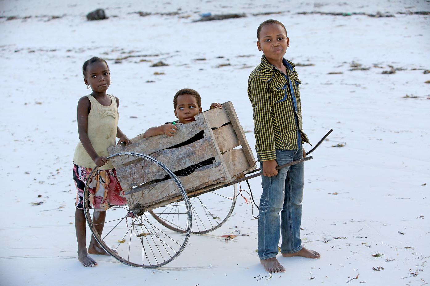 Children on a beach in Zanzibar, Tanzania