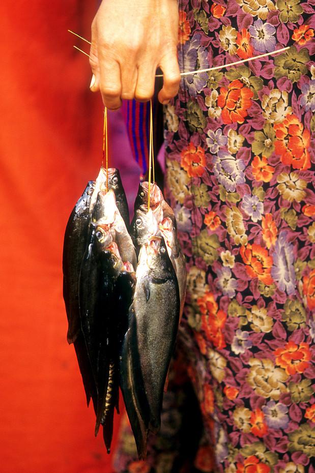 Burmese lady & fish at Inle Lake, Myanmar