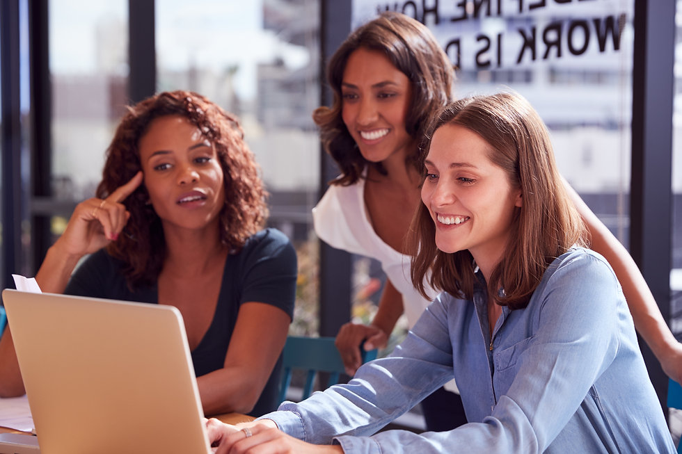 three-businesswomen-with-laptop-at-desk-