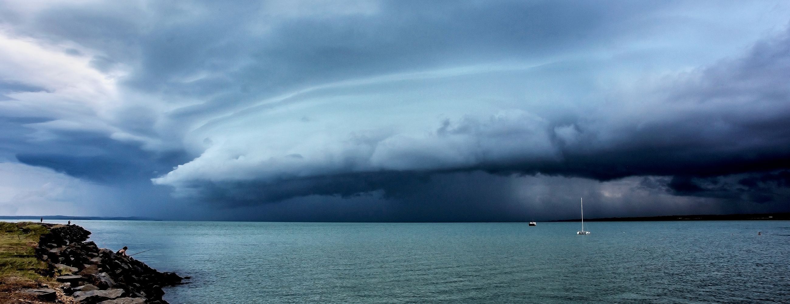 Fishing with the Storm at Urangan Harbour