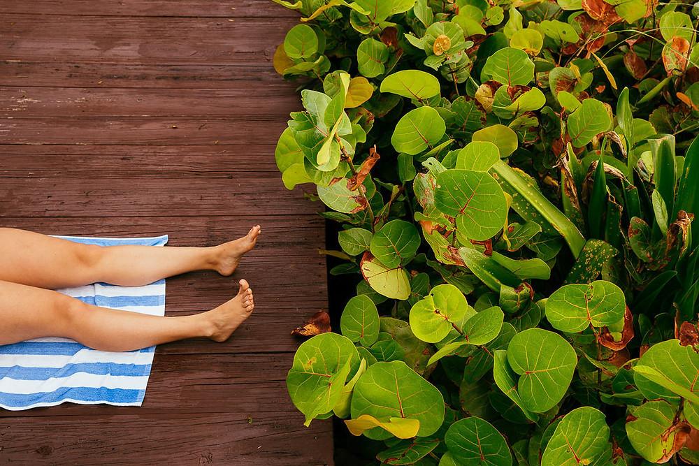 beach towl suntanning feet