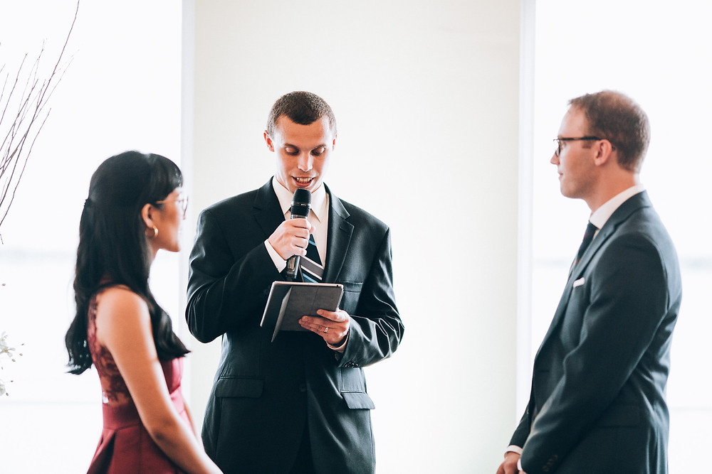 officiant citing vows during a wedding ceremony