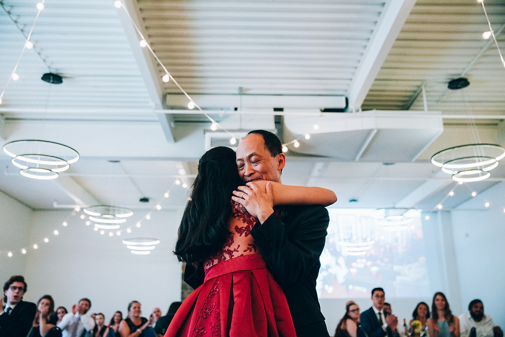 father and daughter hugging during first dance at wedding