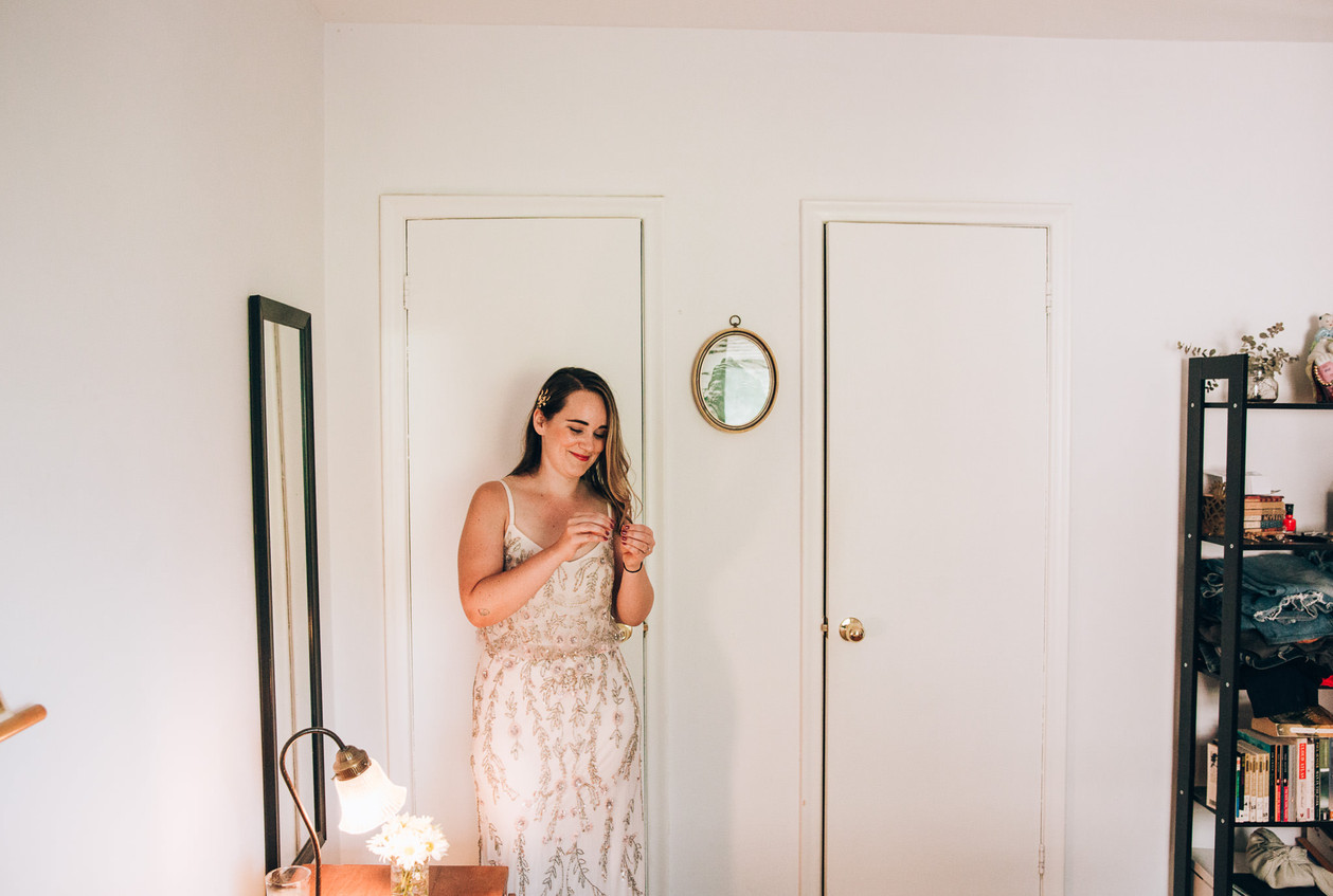 Bride at home getting ready for wedding
