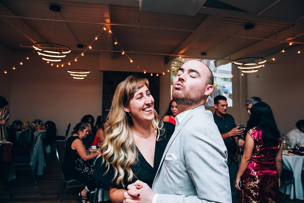 couple having fun dancing at a wedding