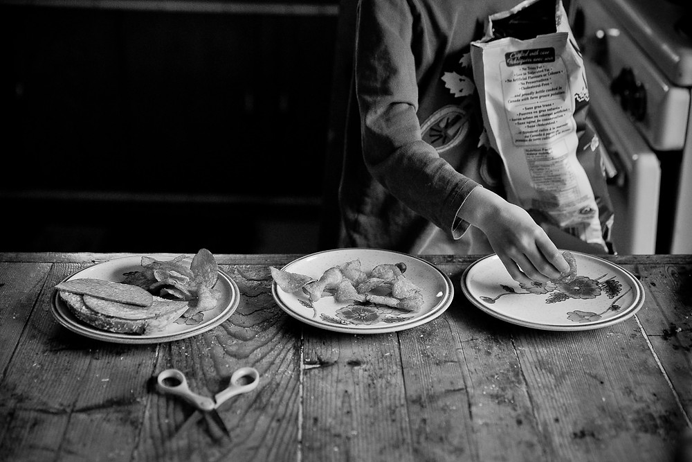 child preparing lunch