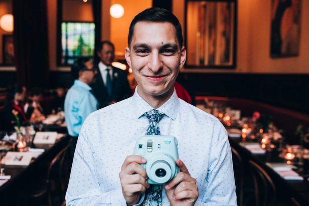 polaroid camera at wedding