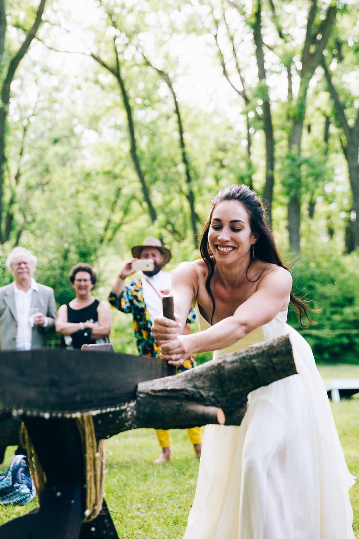 log sawing at wedding