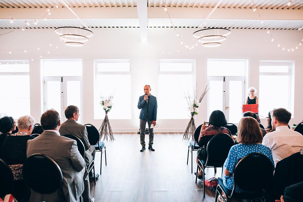 MC making an announcement at a wedding