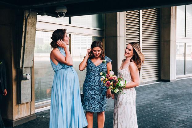 bride and bridesmaids candid photo